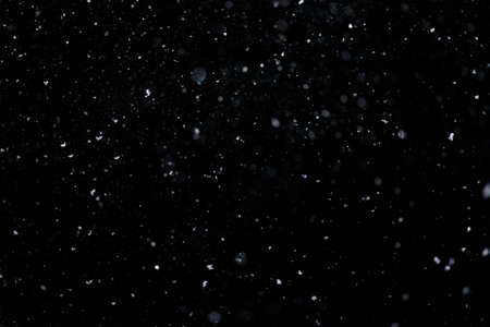 Real falling snow on black background for blending modes in ps. Ver 08 - few snowflakes in blur