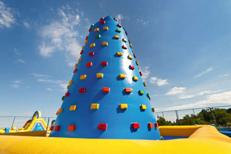 Inflatable climbing tower for children or team building outdoor activities.