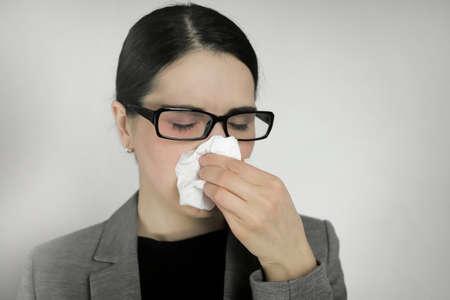 Young woman wearing glasses with flu symptoms. Standard-Bild