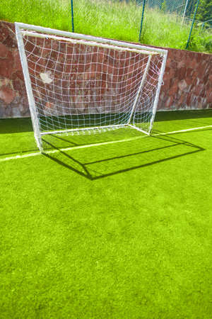 Football or soccer goal on an amateur small field with copy space, vertical Standard-Bild