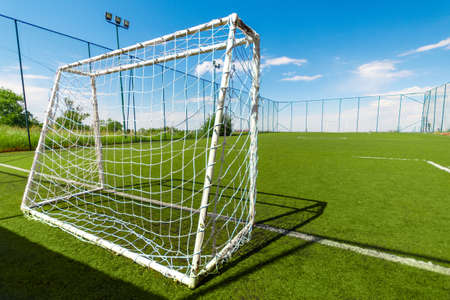 Amateur soccer field with goal, back view.