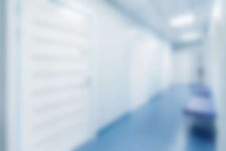 Blurred empty corridor in modern hospital for background.