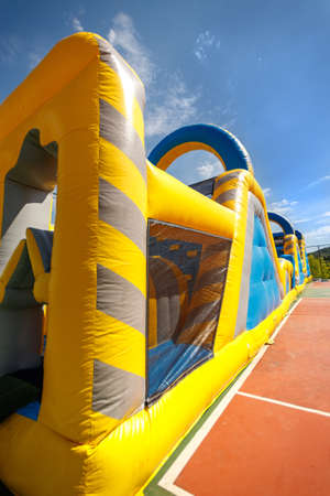 Inflatable obstacle course slide for children games or team building outdoor activities.