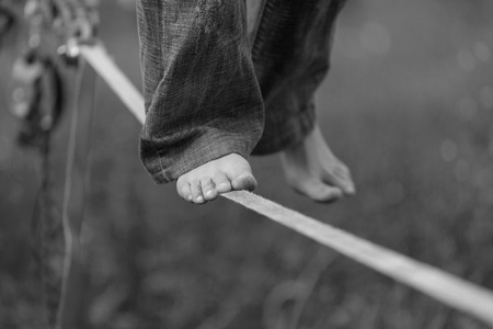 Slackline in the park. Black and white photos Stock Photo