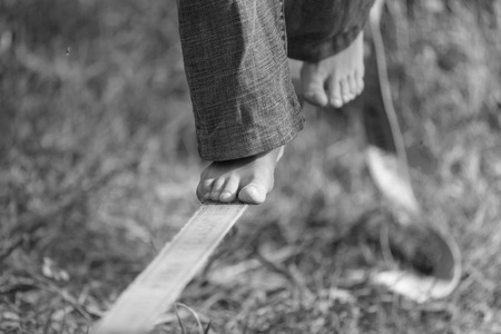 slack: Slackline in the park. Black and white photos Stock Photo