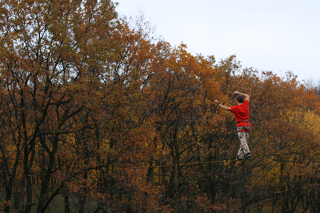 persevere: Fearless highliner walking on tight rope