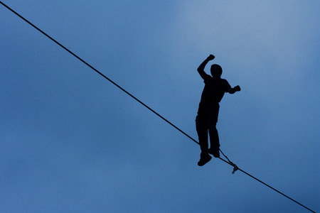 Fearless highliner walking on tight rope