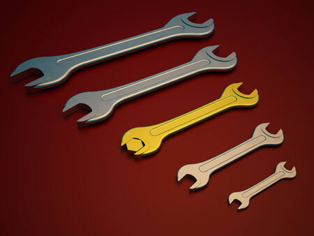 screwing: gold and chrome wrench tool on a red background