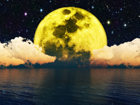 moon in the night sky over water