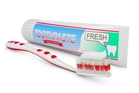 toothpaste tube: toothbrushes near the a tube of toothpaste.