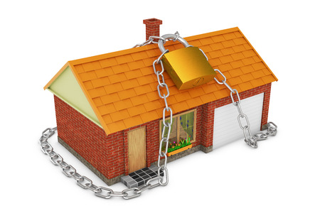 coiled: small house coiled chain with a lock Stock Photo