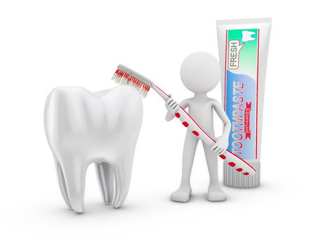 man with a toothbrush cleans tooth on a white background photo