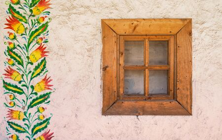 old window: white wall with an old window and ethnic patterns