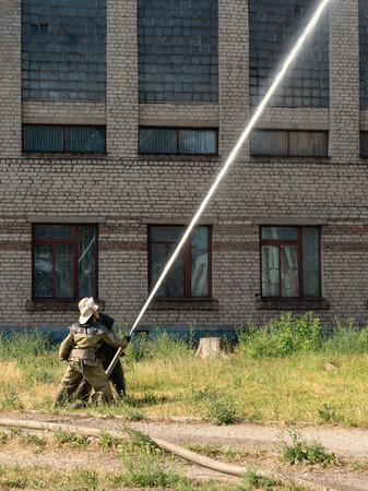 extinguishing: extinguishing a fire in an old threestorey building