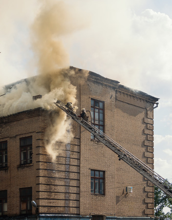 extinguishing: extinguishing a fire in an old three-storey building