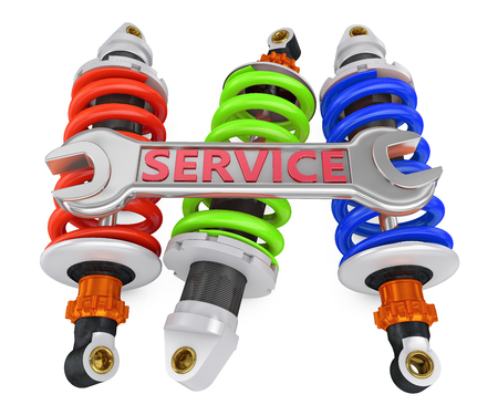shock absorber: three shock absorber and a wrench with an inscription service Stock Photo