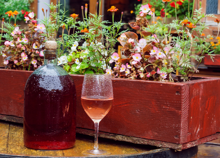 big cork: a large bottle of wine on the background of flowers