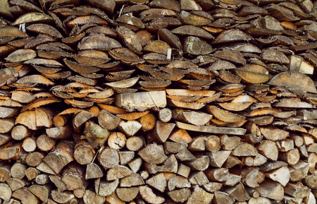 stack of firewood: Stack of firewood, wood logs texture background