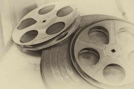 old photograph: reel of film, toned like an old photograph