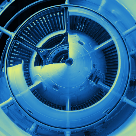 combustion chamber: A detailed exposition of the turbojet engine, toned in blue and yellow tones. Stock Photo