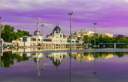 The building of a city ice rink in Budapest against the backdrop of a lake.Pink and violet toning.