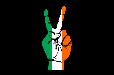 irish pride: Hand making the V sign, Ireland flag painted as symbol of victory, win, success - isolated on black background art
