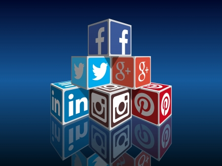 building a social network: Social Media concept cubes - most popular social icons in perpspective building Editorial