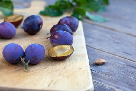 Fresh ripe blue plums on cutting board Stock Photo - 15516299