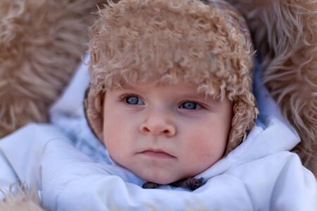Adorable baby boy in winter clothes photo