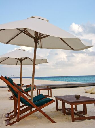longue: Beach chair and umbrella on idyllic tropical sand beach Maldives