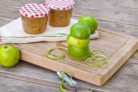 Homemade lemon and lime jam in a glass jar and fresh fruits Stock Photo - 15905076