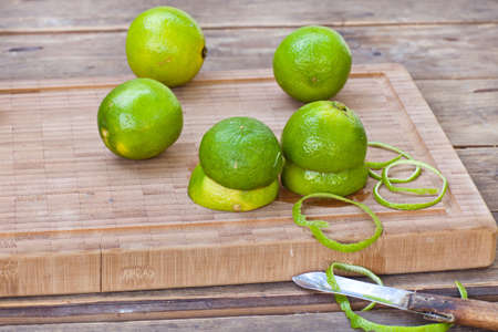 Fresh ripe limes on wooden background Stock Photo - 15905062