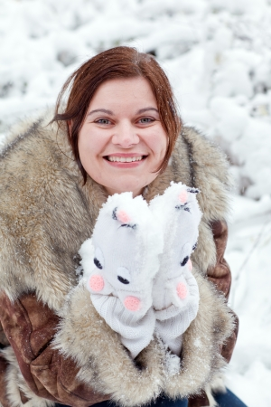 Young beautiful woman having fun with snow outdoors on beautiful winter day Stock Photo - 16010983