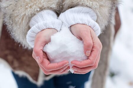 Hands of woman with snow heart in winter Stock Photo - 16010978
