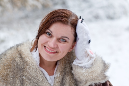 Young beautiful woman having fun with snow outdoors on beautiful winter day Stock Photo - 16010984