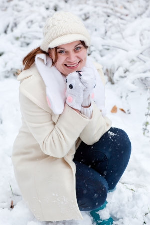 Young beautiful woman having fun with snow outdoors on beautiful winter day Stock Photo - 16011003