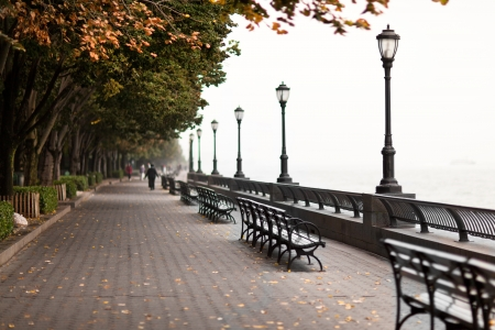 Seafront of New York city on day with heavy fog in autumn Stock Photo