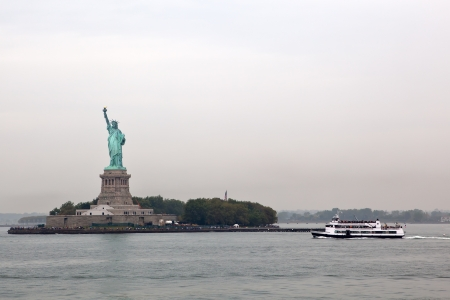 staten: Statue of Liberty and ferry cruises  public transportation , New York on day with fog Editorial
