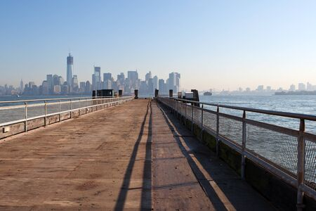 The New York City Downtown skyline at the afternoon from bridge photo