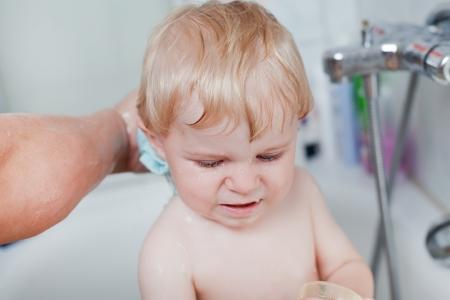 Adorable toddler taking bath in bathtub Stock Photo - 16250254