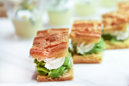Profiteroles with ice cream and green cream photo