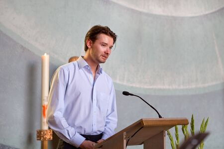 Young man preaching in christian catholic church photo