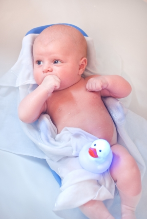Little baby with blue eyes taking bath in bathtub Stock Photo - 16523754