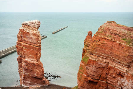 Cliff line of Heligoland with the Tall Anna, the landmark of Heligoland, Germany