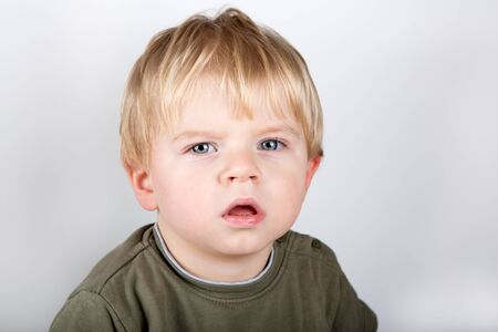 Portrati of adorable toddler with blue eyes and blond hair with white background Stock Photo - 16732338