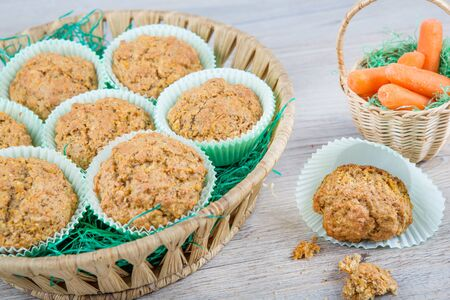 Homemade fresh baked carrot muffins with hazelnut and cinnamon on wooden background Stock Photo