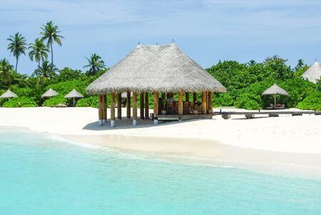 Beautiful beach with white sand and bar villa of island on Maldives
