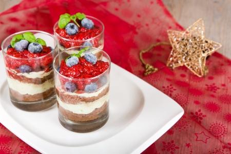 Sweet dessert tiramisu with strawberry, fresh blueberry and basil cream with Christmas decoration