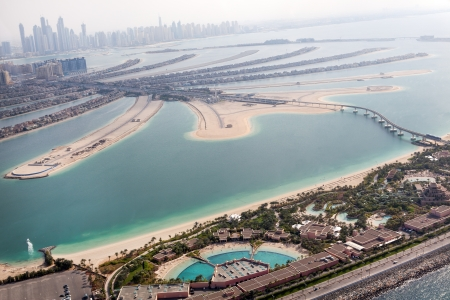 occupancy: Jumeirah Palm island in Dubai with skyscrappers on the background