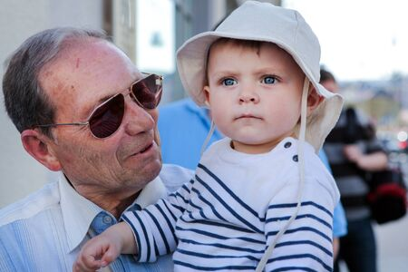 Grandfather with little baby boy in summer city Stock Photo - 17213240